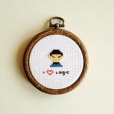 This itty bitty cross stitch piece features our favorite Vulcan and the phrase I [heart] Logic. Comes ready-to-hang in a faux wood hoop (2.5 diameter).    See also, the companion piece I [heart] Ladies featuring a tiny Captain Kirk.