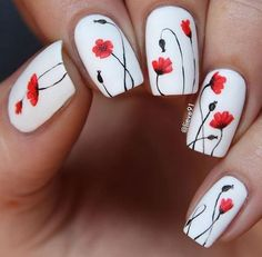 Definitely a work of art in a once blank canvass. These beautiful red flowers look effortlessly magnificent in a white backdrop. (nail art on we heart it)