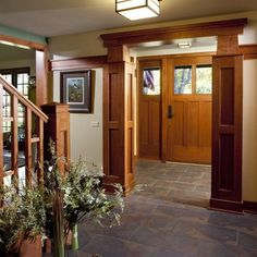 Love the corner molding treatments for the doorway here (and almost all of the rest of the trim).  Fantastic Craftsman style entrance.