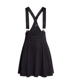 Short, flared bib-overall skirt in thick jersey. Black Dungarees, Overalls, Shorts, Dungaree Skirt, Black Flare Skirt, Flared Skirt, Overall Skirt, Jersey Skirt, Skirt Outfits