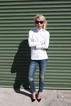 The trick to this outfit is all in the styling: Staples like straight blue jeans perfectly ripped at the knee, white button-down (buttoned all the way up), and black pumps look totally hip.  Photo: Lulu and Your Mom  Read more: http://stylecaster.com/spring-chic-50-stellar-street-style-outfits-to-copy-right-now/#ixzz3TgwDR3kM
