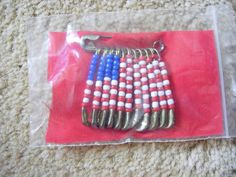 safety pins and beads--I remember doing these when I was a Girl Scout.  Great kid craft!
