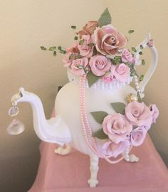 Elegant teapot with carved pink roses