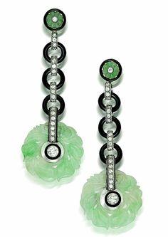 A pair of art deco black onyx, jadeite jade and diamond pendant earrings, circa 1920s.
