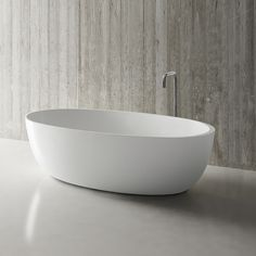 New from Italy this adorable halo petite blu•stone™ freestanding bathtub is the perfect fit for any smaller bathroom   #cute #new #blustone #petite #bathtub #bathroom #decor #interior #interiordesign #interiorinspiration #smallspaces #condo #condodesign #luxuryhomes #luxuryliving #italian #italy #modern #modernhome #moderndesign #blu #blubathworks