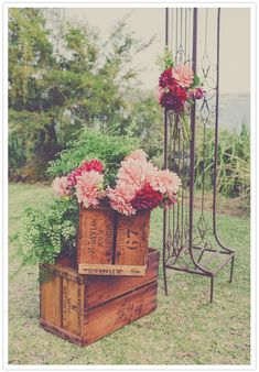 Flowers and vintage crates for ceremony decor