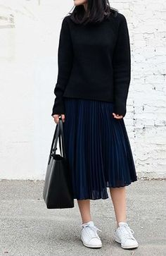 pleted skirt and sneakers