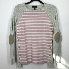 J.Crew pink and grey sweater size XS Beautiful pale pink and cream stripe. Grey back and sleeves with elbow patches. Slight pilling under the arms. Button details on sides. Very clean! No holes. J. Crew Sweaters
