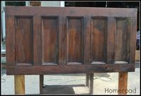 homeroad: Old Door Headboard --stain it? just a regular white door currently