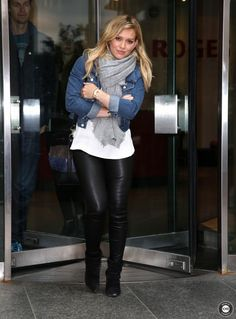 Hilary Duff wearing Isabel Marant Andrew Calfskin Velvet Leather Boots in Black and Proenza Schouler Python and Leather Bucket Bag.