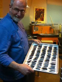 Kevin Buck of Chocolate Necessites in Bellingham WA with freshly dipped orange peel...yum!