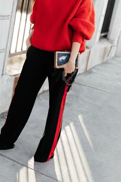 Tuxedo pants and red sweater outfit