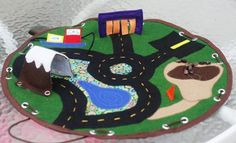 a gazillion different homemade car play mats. I love this one: 3D, complete with shoelace gas hoses, tunnel and carwash... and it closes to carry the cars!