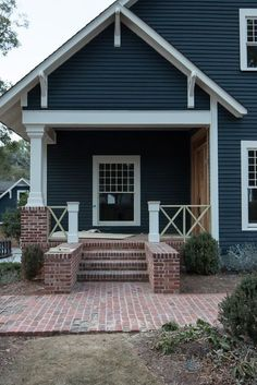 A sneak peek reveal on the blog at our dark blue gray exterior house siding! All paint colors are on the blog for our 1905 craftsman home restoration. Follow along on our journey! sherwin-williams-benjamin-moore-exterior-paint-colors-ideas-dark-grey-gray-blue-navy