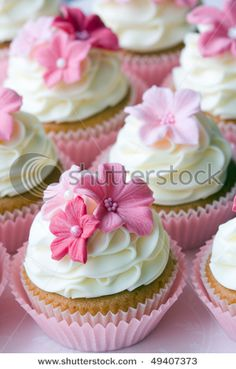 Pink & white wedding cupcakes with flower accents.