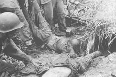 japanese army feild back pack   Marines Drag Dead Japanese Soldiers from Their Bunker Near Point ...