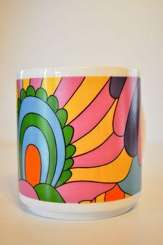 Vintage Flower Power West German Coffee Cup -- Peter Max-like Design Mug. $12.00, via Etsy.