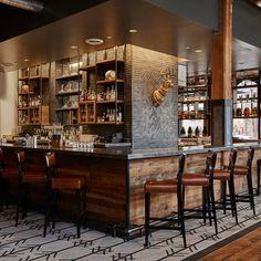 Hewing Hotel Minneapolis, Minnesota scene wooden Bar bookselling restaurant library liquor store café