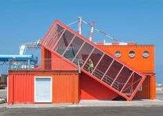 The precariously balanced shipping container at this Israeli port office houses a staircase.