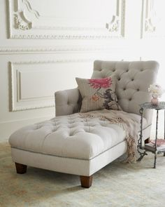 Traditional chaise lounge upholstered with fabric and