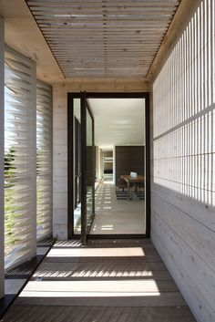 A large pivoting glass door welcomes you to this home.