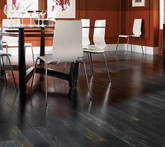 Black wood flooring in dining room | Flooring Ideas | Floor Design Trends