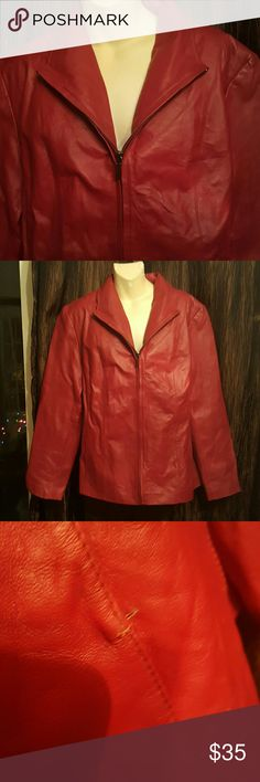 """Genuine Leather Nice Red leather zip up coat. Very classy to wear.  2 front pockets Fully lined Length 25.5""""  Arms measures 24"""" 1 small flaws small rip in seam see pic. Price accordingly.  Beautiful coat on. East 5th Jackets & Coats Blazers"""