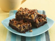Six Layer Brownie Bars from Betty Crocker. Topping made with coconut, condensed milk, chocolate chips, toffee bits and pecans