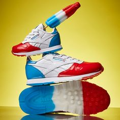 Chase after the ice-cream truck faster in the new popsicle-themed sneakers! Reebok introduces a new way to enjoy your popsicle in the Kids' Classic Leather 'Bomb Pop' kicks (BS7245). These grade school 'Bomb Pop' sneakers in the popsicle-inspired Dessert Pack see a red, white, and blue synthetic leather upper, foam midsole to cushion fast feet, and a tricolor, firm rubber outsole for increased durability and style. Beat the summer heat in these cool popsicle kicks! For sizing information, be…