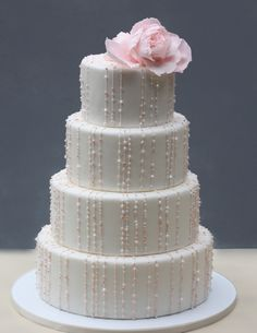 Delicate sugar strings with hand piped beads add sparkle ...topped with a pink rose....via Roxys cake blog