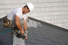 tornado proofing your house ... www.houselogic.com  Man installing interlocking metal shingles - helpful tornado roof tips.