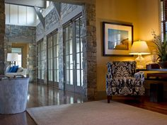 This is a view on HGTV's 2012 Dream Home.  I love the Gray painted doors surrounded by stone wall and the batton siding on the upper wall.