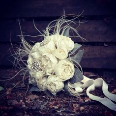 Ivory silk wedding bouquet with feather and brooch by nerobianco, $420.00