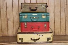 ReviveVintageRentals.com  Going somewhere, we have suitcases of all colors and sizes perfect for your bon voyage party, travel-themed birthday day or just as a fabulous accent for your wedding day