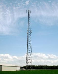 Rogers Wireless lattice cell tower on the corner or Mandaumin Rd. and London Line.