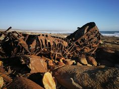 The Aristea is a shipwreck stranded at Hondeklipbay, South Africa. The remains are corroding leaving a red residue on the rocks and beach adding to a unique experience at this beach. Shipwreck, The Rock, Places To See, South Africa, Grand Canyon, Rocks, Unique, Beach, Nature