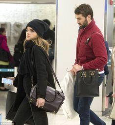 Still going strong: Emma Watson with her boyfriend Matthew Janney at JFK airport... http://dailym.ai/1i9vQWb#i-5c630d37