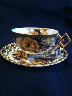 CASTLE Hand-painted cup and saucer