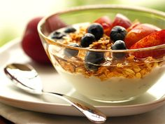 i also love low fat vanilla yogurt with a granola cereal and fresh fruit- yum