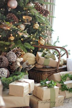 Keep your wrapping paper simple and beautiful this year by using kraft paper tied with simple greenery, green bows and string.