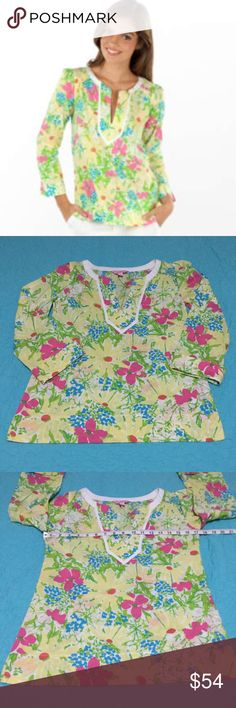 Lilly Pulitzer Thandie Tunic  Blue Eyed Girl Print This preppy floral tunic top is the Thandie style from Lilly Pulitzer in the Blue Eyed Girl print. This pretty shirt features a v style neckline trimmed in white with 3/4 length cuffed sleeves. The preppy floral print has a white background with yellow daisies, pink and blue blossoms and is accented with green leaves. A sensational piece to add to your spring and summer wardrobe. Everyone needs a little Lilly in their life! Gently used. EUC…