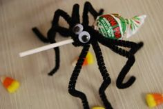 Spider Pops     Let guests make these leggy lollipops as a party activity and a take-home favor.       4 black pipe cleaners  Lollipop  Googly eyes  Glue    Holding all four pipe cleaners, center them at the base of the pop and wrap them around the stick once so there are four legs on each side. Bend the legs. Glue on googly eyes. Now, is it a trick--or a treat?