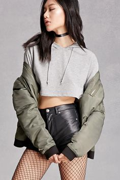 A soft French terry knit crop top featuring a drawstring hood, long dropped sleeves, and a boxy silhouette. This is an independent brand and not a Forever 21 branded item.