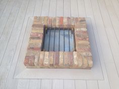 Brick fire pit built in to Millboard decking