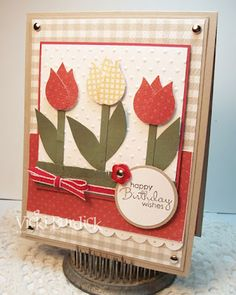 Really cute and easy punch card, cute the tulips are the bird wing from the bird punch!