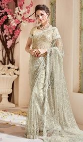 Cream Color Shaded Embroidered Net Designer Sari #designersareeswithprice#expensivedesignersarees Decode your fashion statement as you step out in this cream color shaded embroidered net designer sari. You'll be able to see some fascinating patterns performed with lace and resham work. Upon request we can make round front/back neck and short 6 inches sleeves regular saree blouse also. USD$ 213(Around £ 147 & Euro 162)