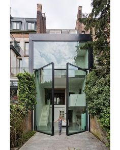 "Sculp IT adds ""world's largest pivoting window"" to an Antwer.- Sculp IT adds ""world's largest pivoting window"" to an Antwerp townhouse (Dezeen) modern architecture, architecture & design, luxury design, see more luxury design at www. Architecture Design, Amazing Architecture, Modern Architecture Homes, Dezeen Architecture, Windows Architecture, Contemporary Architecture, Contemporary Houses, Architecture Awards, Japanese Architecture"