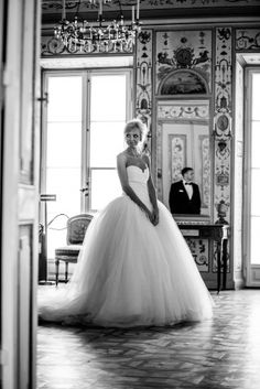 Not crazy about big poofy dresses but have to say that this dress is really pretty and girly and so fairy tale like that I'd totally consider wearing it! also the photo in itself is adorable with the reflection of the groom in the mirror and the look on the bride's face