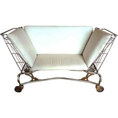 Ah, the creative mind -- loveseat made from two vintage shopping carts, 1stdibs.com