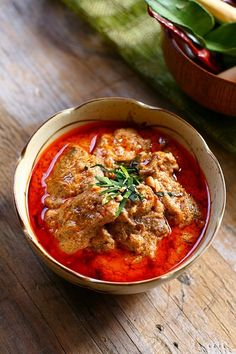 Thai Panang Curry with Beef - an authentic Panang curry is fried in thick coconut cream as opposed to boiling, as in the Red curries, providing a thick, creamy, soup-like gravy. | rasamalaysia.com